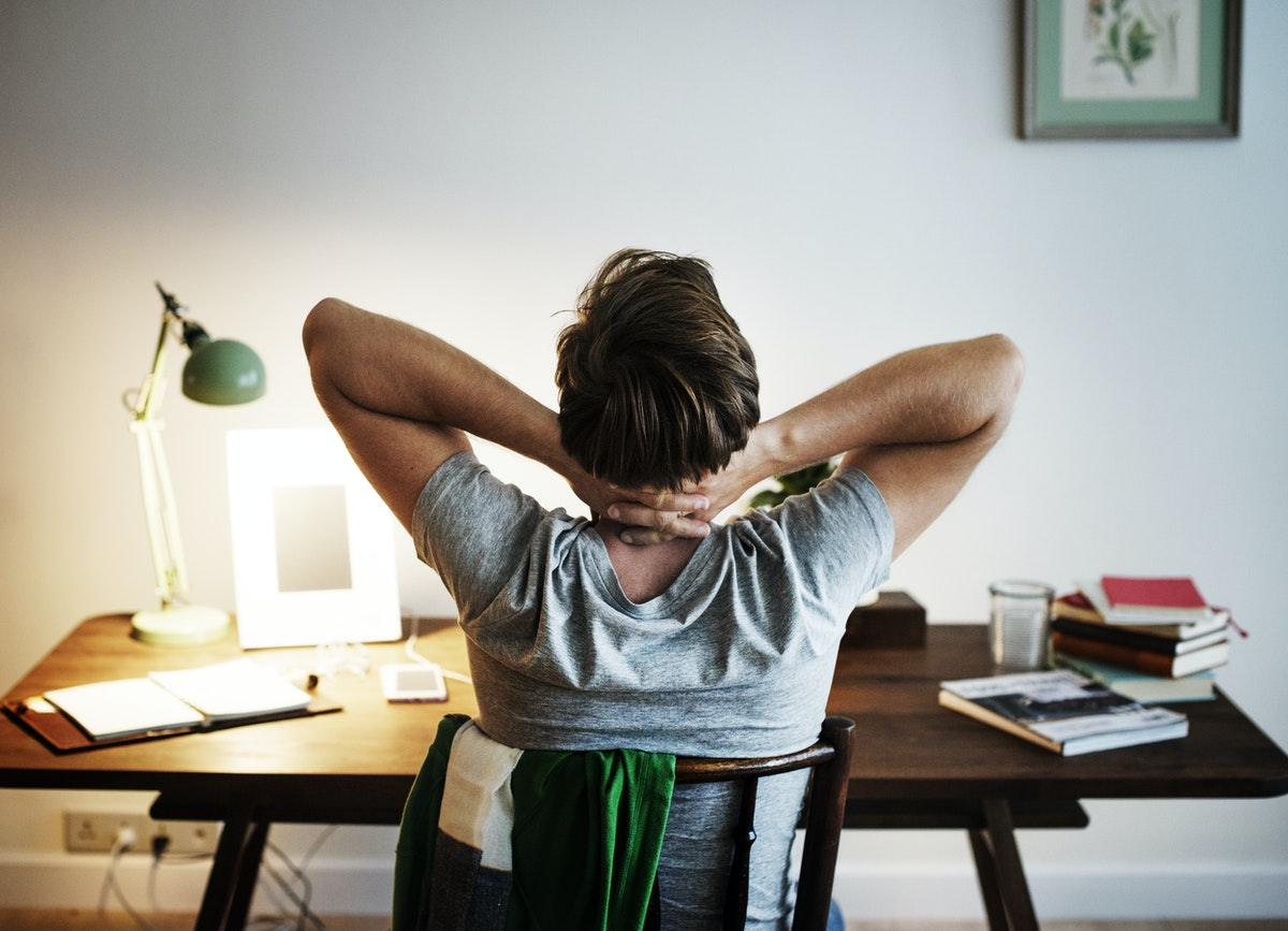 Blog post image - Coping - man at his desk with his hands behind his head